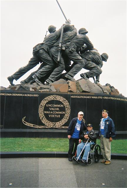 Frank is photographed in front of the Iwo Jima Monument