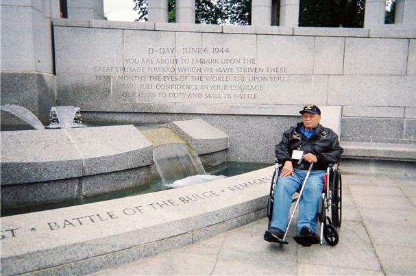 "Frank poses in front of a fountain inscribed ""D-Day"" n which Frank took part. Also enscribed ""The Battle of the Bulge."" Franks bomb group flew in missions to support the surrounded ground troops in that battle."