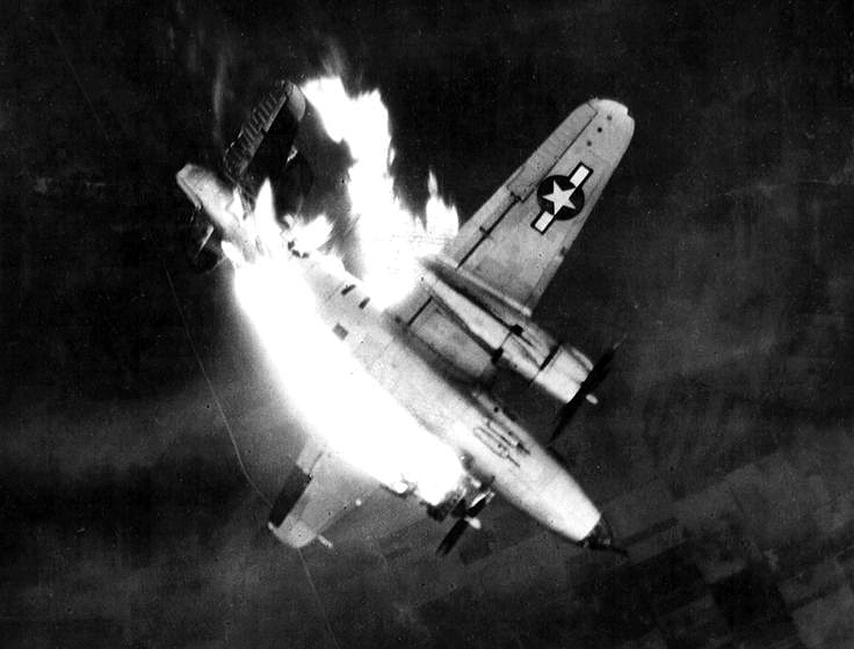 "Bomber ""Marauder"" B-26, serial number 43-34565, Gratis Gladys, 7I-B, 497 Squadron, 344th Bombardment Group, 9th U.S. Air Force is crashing to the ground after receiving a direct hit in the left engine during the bombing of a Erkelenz, Germany, 26 Feb 1945. MACR 12649"