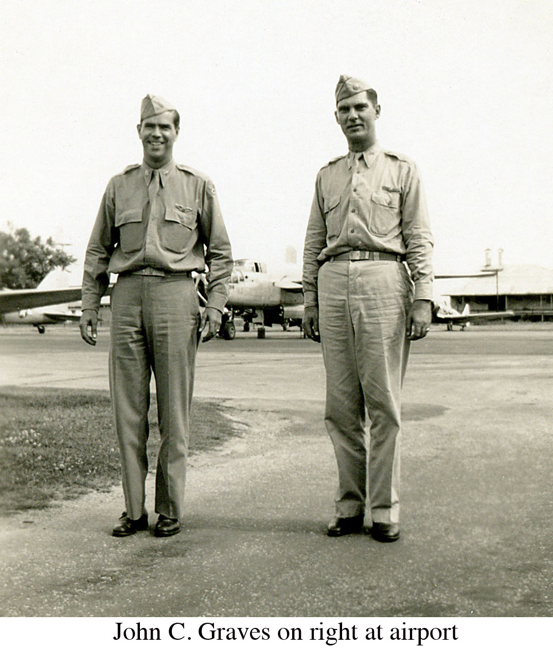 John C Graves on right at airport