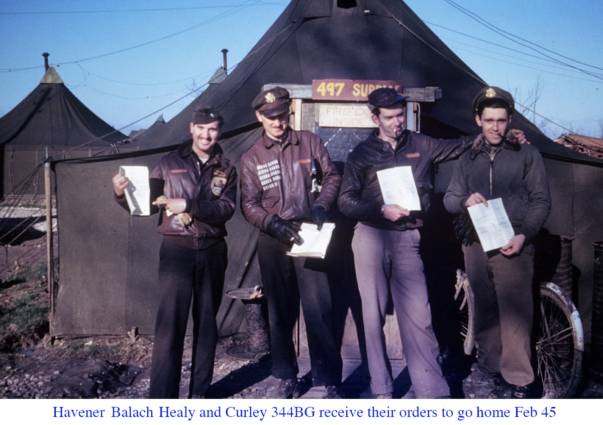 Havener and Balach and Healy and Curley 344BG receive their orders to go home Feb 45 copy