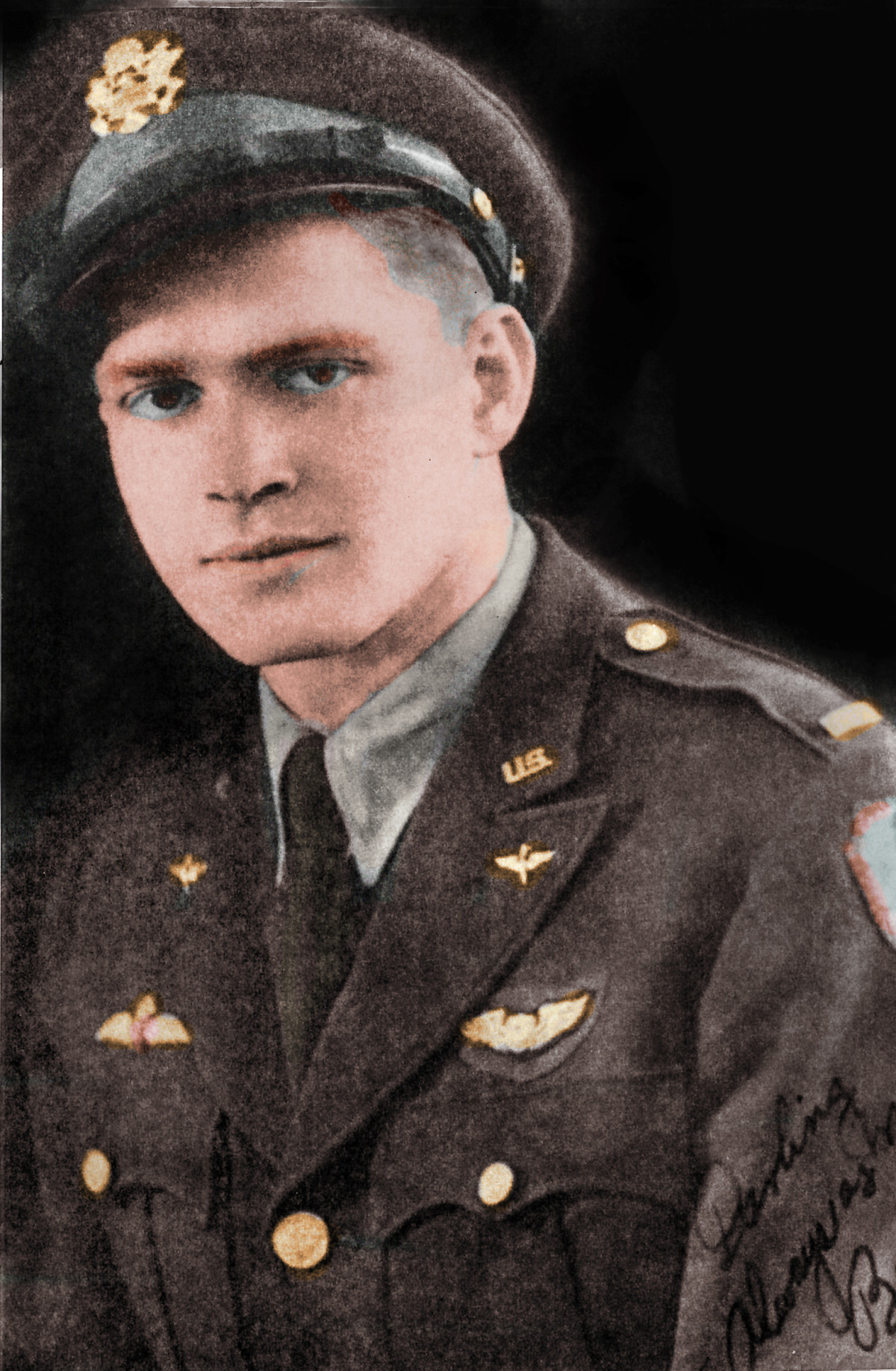 In this colorized photo, Lt. Young is in uniform. Note both RCAF and USAAC insignia.