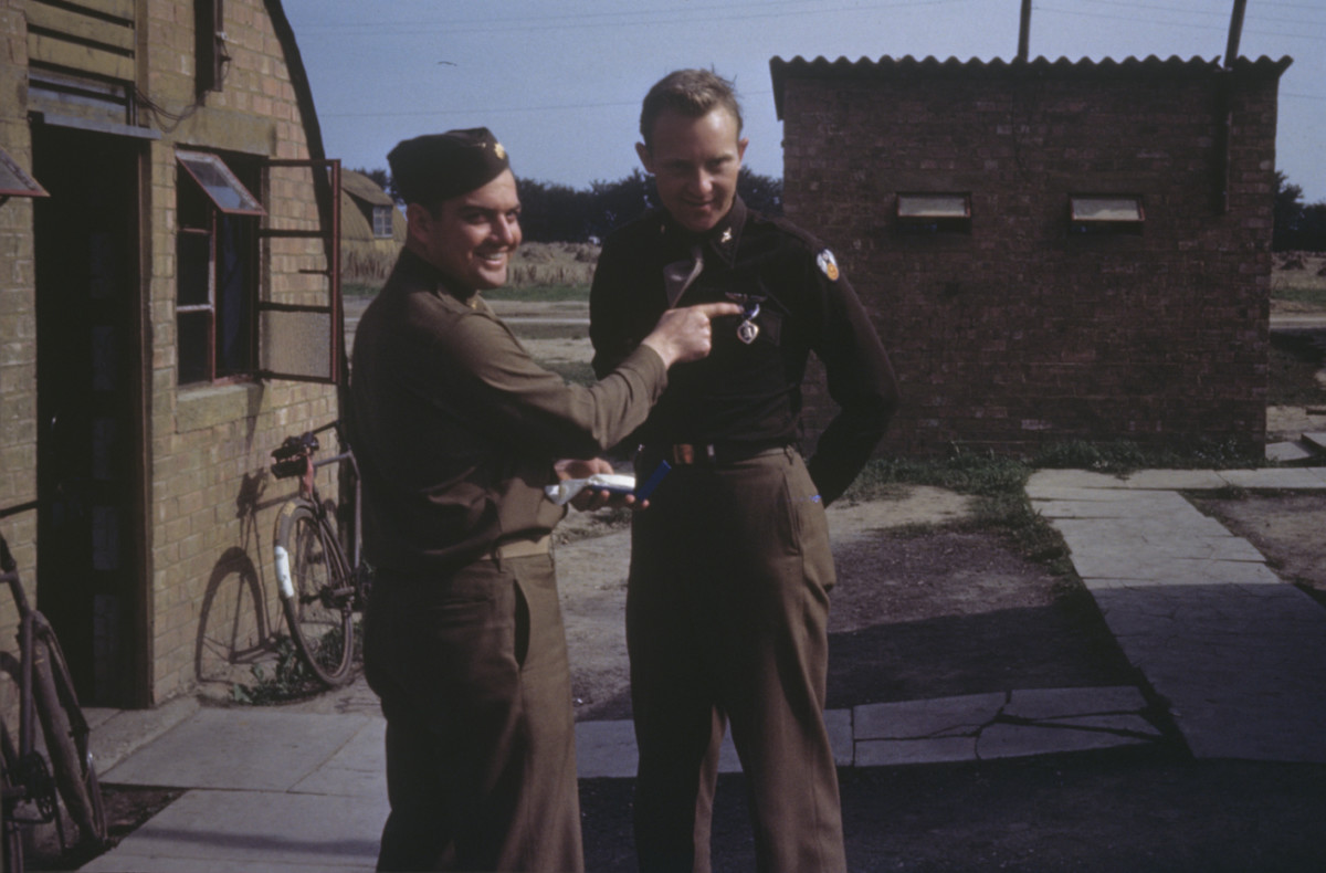 Operations officer DC Brawner and bombardier Fenster with his Purple Heart at Stansted